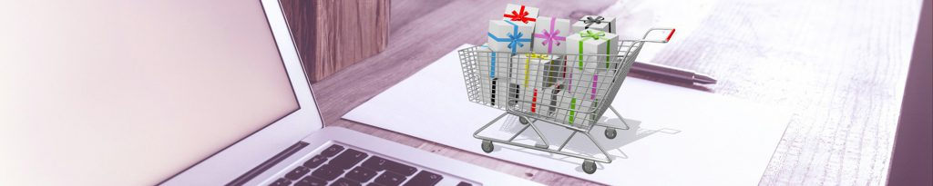 Pricing Page Banner - computer on a desk next to a shopping trolley